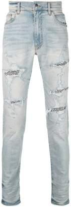 Amiri distressed detail jeans