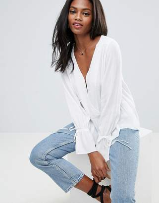 Asos DESIGN Oversized Wrap Blouse with Dip Hem