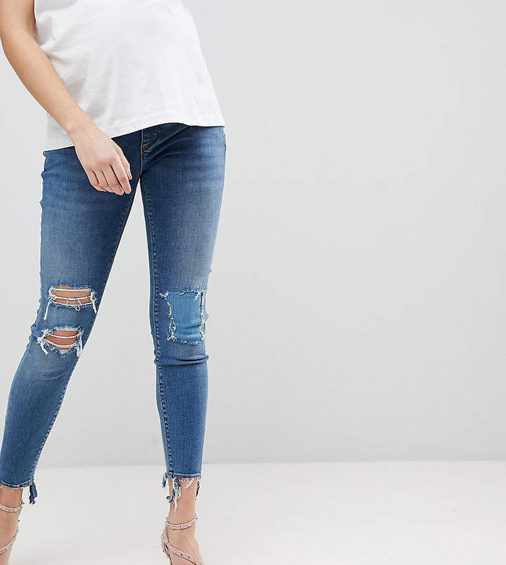 – RIDLEY – Enge Jeans mit hoher Taille, Unterbauchbund und extremer Tana-Waschung mit zerrissenen Knien