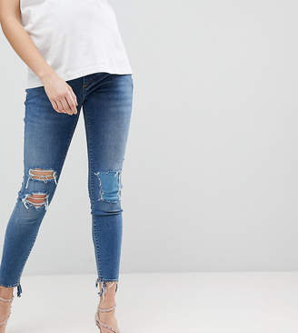 Asos DESIGN Maternity Ridley high waist skinny jeans with under the bump waistband in tana extreme mid wash with busted