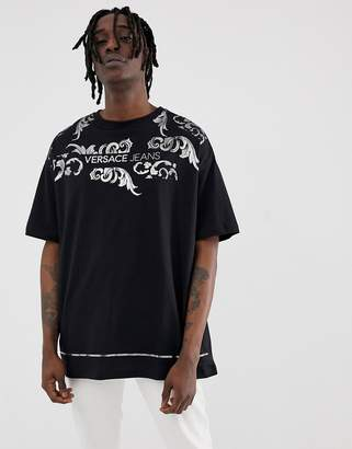 Versace oversized t-shirt in black with gold logo
