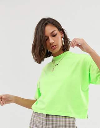 Asos Design DESIGN boxy neon t-shirt with grown on neck in washed neon green