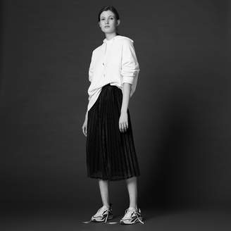 Sandro Long pleated skirt with bow at the waist