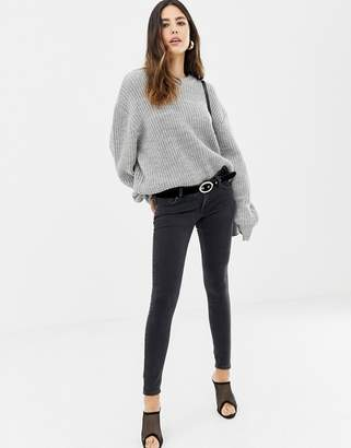 Asos DESIGN extreme low rise skinny jeans in washed black
