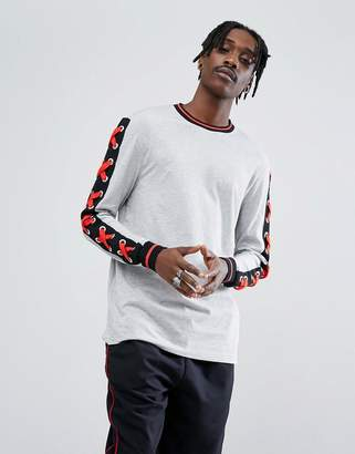 Asos DESIGN Longline Long Sleeve T-Shirt With Eyelet Lace Up Sleeves