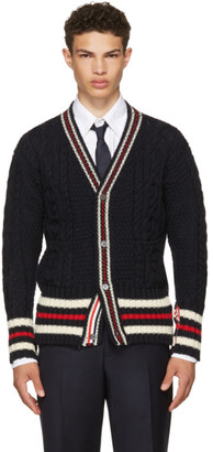 Thom Browne Navy Aran Cable Cricket Stripe Classic V-Neck Cardigan $780 thestylecure.com