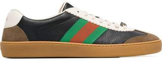 Gucci black logo embossed leather sneakers