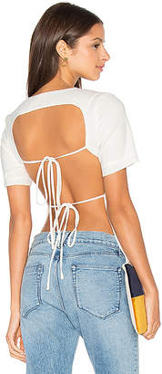 Lavish Alice Open Tie Back T-Shirt in White. - size UK 14 / US XL (also in )