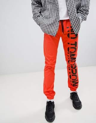 Asos Slim Joggers With Text Print In Orange