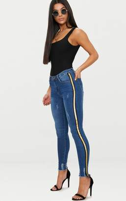 PrettyLittleThing Mid Wash Gold Sports Stripe Distressed Skinny Jean