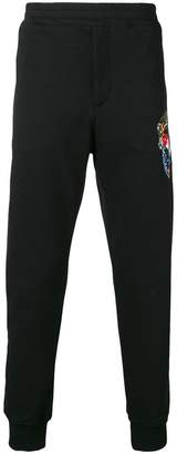 Alexander McQueen skull embroidered track pants