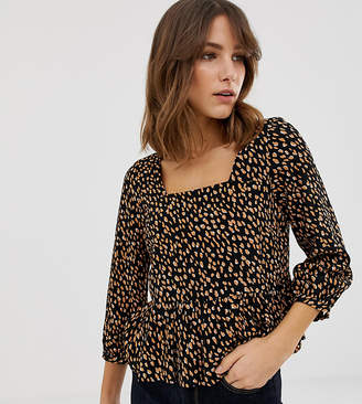 New Look shell top with peplum in spot print