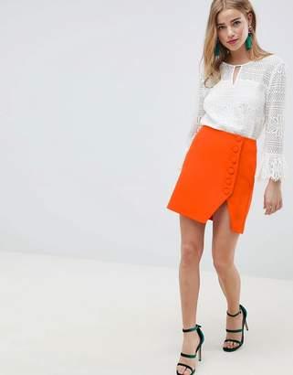 Asos Design DESIGN side button mini skirt with split front