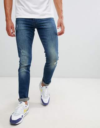 Armani Exchange J14 skinny fit 5 pocket stretch jeans with abrasions in mid wash