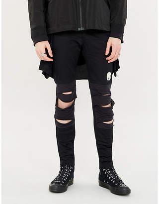 Undercover Waist-attachment ripped cotton-blend jogging bottoms
