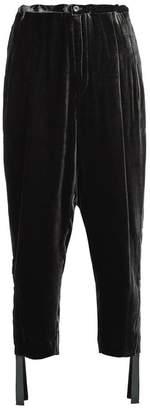 Toga High-rise carrot-leg velvet trousers