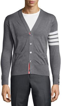 Thom Browne Merino Wool V-Neck Cardigan with Four-Bar Stripe $950 thestylecure.com