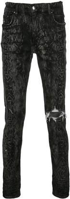 Amiri python print skinny jeans