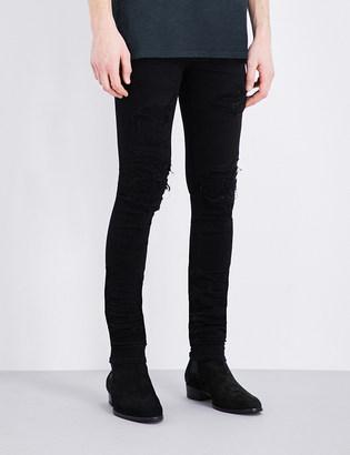 Amiri Mid-rise skinny stretch-denim jeans $1,015 thestylecure.com