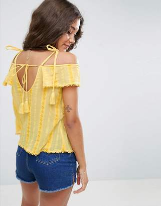 4ffb8e0323330 Asos Broderie Trim Cold Shoulder Top with Tassels
