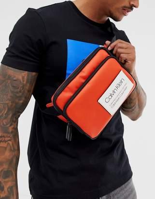 7b394e9c6e Calvin Klein Avenue logo crossbody bag in orange