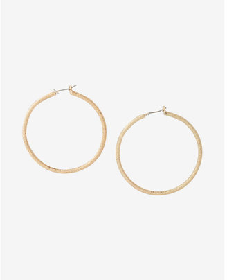 Express Shiny Diamond Dust Hoop Earrings $14.90 thestylecure.com