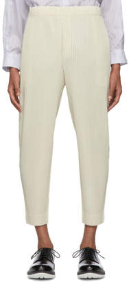 Homme Plisse Off-White Pleated Tapered Trousers