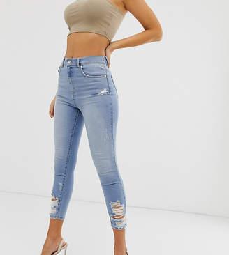 NA-KD Na Kd distressed hem skinny cropped jeans in mid blue