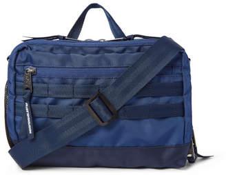 Indispensable Dinky Canvas Messenger Bag