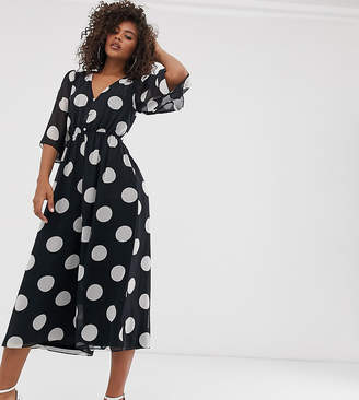 Asos Tall DESIGN Tall button front waisted open back jumpsuit in spot print
