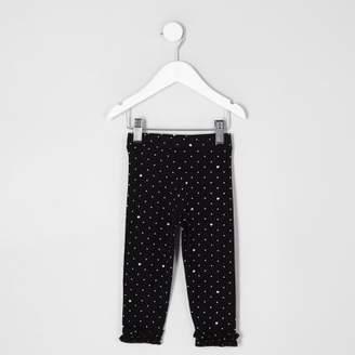 River Island Mini girls black polka dot frill hem leggings