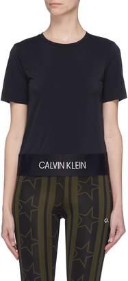 Calvin Klein Slit back logo hem cropped performance T-shirt