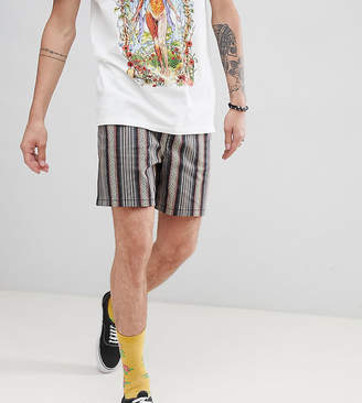 Asos DESIGN festival slim longer shorts with elasticated waistband in gray geo-tribal stripe print