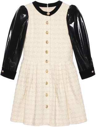 Gucci Houndstooth tweed dress with vinyl sleeves