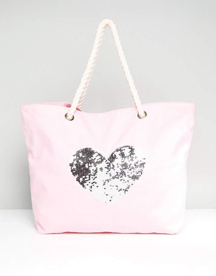 – Strandtasche aus Baumwolle in verwaschenem Hellrot mit Pailletten-Herz
