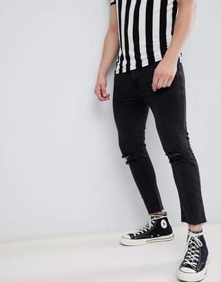 Asos DESIGN super skinny cropped jeans in washed black with busted knees