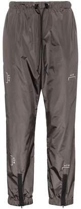 A-Cold-Wall* logo print zipped nylon trousers