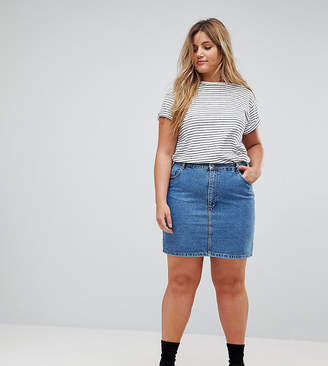 Asos DESIGN Curve denim original high waisted skirt in midwash blue