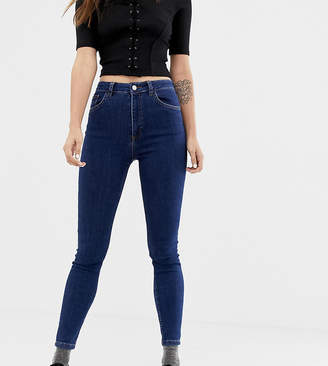 Reclaimed Vintage The '90 skinny jeans in dark stone wash