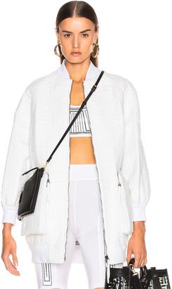 Fendi Logo Embossed Leather Jacket in White | FWRD
