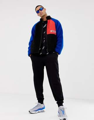 Mennace zip thru jacket in nylon with borg
