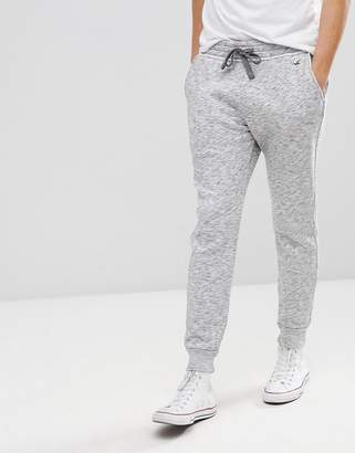 Hollister Icon Logo Fleece Cuffed Jogger In White/Black Printed Texture