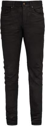 Saint Laurent Waxed cotton-blend jeans
