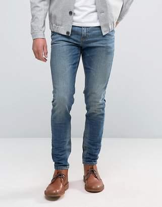 Asos Design Skinny Jeans In 12.5oz Mid Blue
