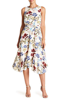 Gabby Skye Belted Floral Sharkbite Hem Dress