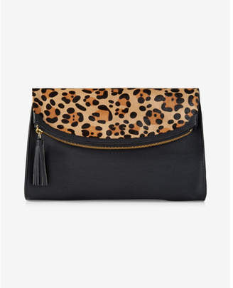 Express leopard print rounded fold-over clutch $49.90 thestylecure.com