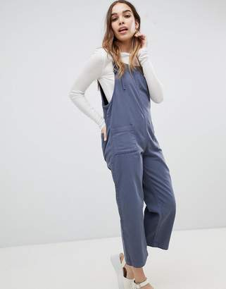Monki denim overalls with organic cotton and tie strap detail in mid blue