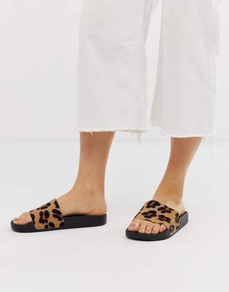 Asos Design DESIGN Fizzer leather sliders in leopard