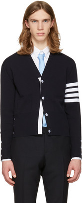 Thom Browne Navy Trompe L'Oeil Classic V-Neck Cardigan $990 thestylecure.com