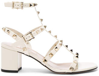 Valentino Patent Leather Rockstud Sandals in Light Ivory | FWRD